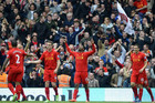 Liverpool are all smiles after coming from behind to beat Fulham 3-1 (Reuters)