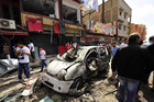 The scene of the car bomb explosion outside a hospital in the city of Benghazi (Reuters)