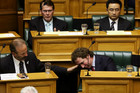 A teary Aaron Gilmore is comforted by backbench MP Cam Calder (Getty)