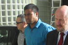 Julian Savea (centre) arrives at court with lawyer Noel Sainsbury (right)