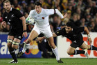 France's Francois Trinh-Duc, in white, avoids the tackle of New Zealand All Blacks' Piri Weepu during the 2011 World Cup final at Eden Park (Reuters file)