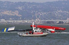 The Artemis Racing yacht is towed to shore after capsizing in the San Francisco Bay (Reuters)