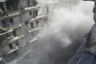 Smoke rises during a rebel clash in Aleppo  (Reuters)