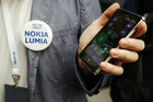 A worker poses with the new Nokia Lumia 925  (Reuters)