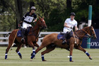Prince Harry (right) playing in a polo match in Greenwich (Reuters)