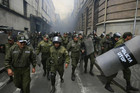 Riot policemen move to take positions during a protest rally in La Paz (Reuters)	