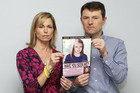 Kate and Gerry McCann pose with a picture of how Madeleine might look now  (Reuters)