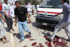 People gather at the site of a bomb attack in Baquba, about 50 km northeast of Baghdad (Reuters)