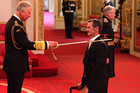 Mark Todd receives his knighthood from Prince Charles at Buckingham Palace  (AAP)