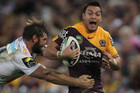 Alex Glenn is tackled by Dave Taylor (AAP)