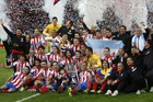 Atletico Madrid with the trophy (Reuters)