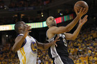 San Antonio Spurs' Tony Parker (R) drives to the basket against Golden State Warriors' Harrison Barnes (Reuters)