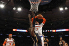 New York Knicks' Carmelo Anthony (7) shoots over Indiana Pacers' Ian Mahinmi (Reuters)