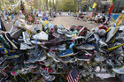Running shoes adorn a barrier surrounding the memorial site (AAP)