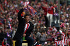 Atletico Madrid fans celebrate their team's victory against Real Madrid (Reuters)