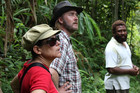 Comedians Michele A'Court (L) and Jeremy Elwood (C) visit a coffee plantation in Papua New Guinea (Photo: Fairtrade ANZ)