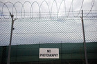 No photography signs are posted on a fence at Guantanamo Bay (Reuters)