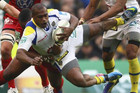 Clermont's Sitiveni Sivivatu (C) is tackled by Toulon's Mathieu Bastareaud in the Heineken Cup final (Reuters file)