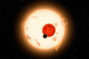 NASA handout image shows an artist's concept of the planet Kepler-16b with its two stars (NASA)