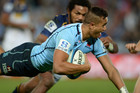 Peter Betham scores for the Waratahs (AAP)