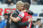 Arsene Wenger embraces Lukas Podolski (AAP)