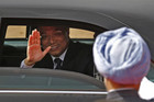 Chinese Premier Li Keqiang waves as India's Prime Minister Manmohan Singh watches (Reuters)