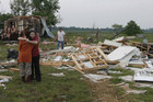 Shawnee residents comfort each other after their houses are flattened (Reuters)