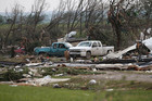 Vehicles are seen amongst storm debris in Oklahoma (Reuters)