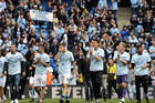 Manchester City's players salute the crowd (Reuters)