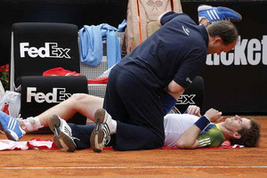 Andy Murray of Britain receives medical care at the Rome Masters (Reuters file)