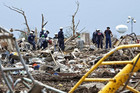 Rescue workers look through the rubble at Plaza Towers Elementary school in Moore, Oklahoma (Reuters)