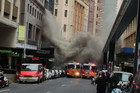 Smoke billows from building in Sydney's CBD. (Photo: Twitter, Greg Charlton) 