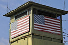 A US Marine guard tower overlooks the northeast gate leading into Cuba territory at Guantanamo Bay (Reuters)