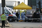 Police forensics officers investigate the crime scene in Woolwich, southeast London (Reuters)