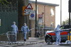 Police forensics officers at the crime scene in Woolwich, southeast London (Reuters)