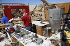Residents try to salvage belongings after the tornado (Reuters)