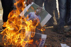 Demonstrators burn a poster of former India test bowler Shanthakumaran Sreesanth (Reuters file)