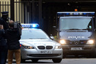 A police van carrying IRA bombing suspect John Anthony Downey departs the Westminster Magistrates Court in London (AAP)