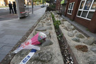 Flowers lie in Woolwich near where the man was killed (Reuters)