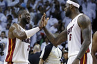 Miami Heat's LeBron James high fives Dwyane Wade (Reuters)