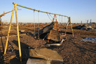 Debris is scattered around damaged playground equipment (Reuters)