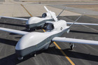 Two unmanned drones parked in California (Reuters)