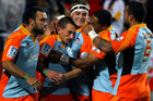 The Chiefs celebrate Aaron Cruden scoring the opening try (photosport)