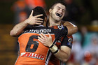 James Tedesco (right) celebrates the win with Benji Marshall (AAP)