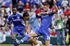 Manchester City's Sergio Aguero (C) and Chelsea's Gary Cahill fight for the ball during their friendly in America (Reuters)
