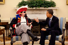 Barack Obama speaks to Cody Keenan, dressed as a pirate for the White House Correspondents Association dinner (Reuters)