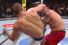 Junior Dos Santos delivers the spin kick to Mark Hunt