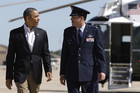 US President Barack Obama is greeted as he arrives to board Air Force One for travel to Oklahoma (Photo: Reuters)