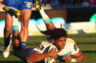 Jamal Idris scores his second try of the match for the Titans (AAP)
