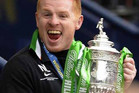 Celtic's manager Neil Lennon lifts the trophy following their Scottish Cup Final (Reuters)